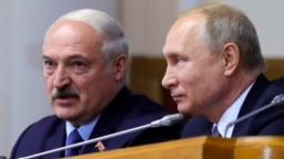 Belarusian President Alyaksandr Lukashenka (left) and Russian President Vladimir Putin in 2019. The unprecedented election in Belarus hands Putin's Kremlin a challenge and a potential opportunity.