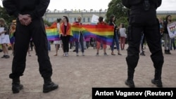 Interior Ministry officers stand near an LGBT rally in St. Petersburg on August 12.