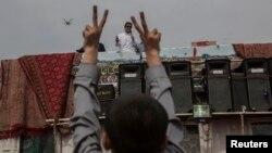 Imran Khan addresses supporters outside the parliament building in Islamabad on August 28.