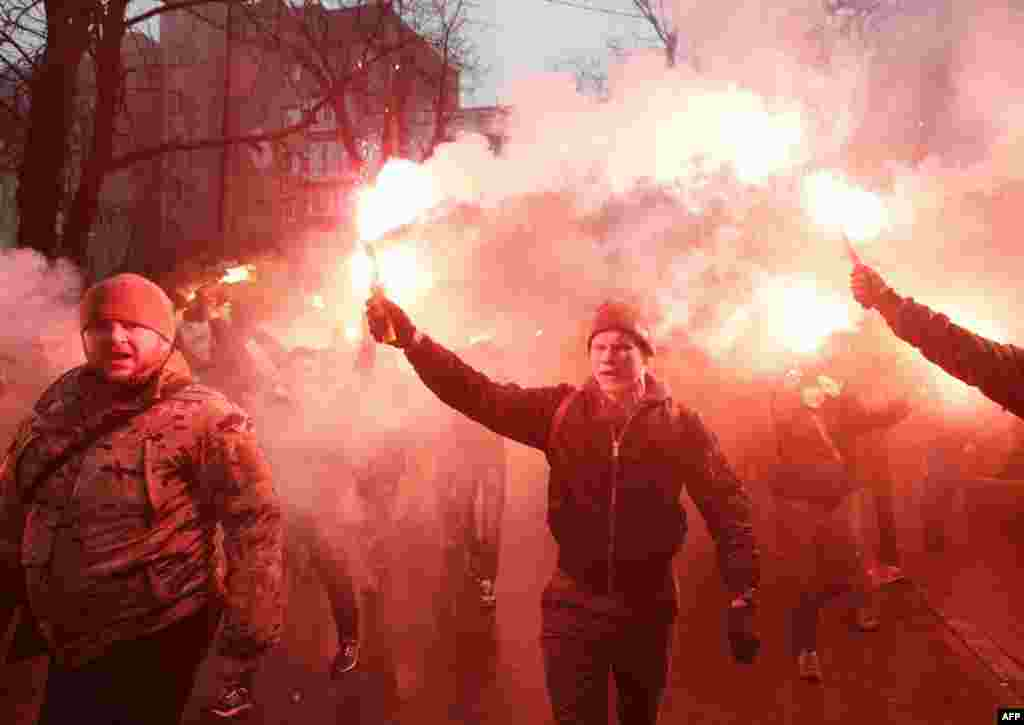 Members of the Ukrainian volunteer battalion Azov hold flares during a protest outside the Ukrainian Security Services (SBU) prison in Kyiv on March 1. The protesters were demanding the release of Stanislav Krasnov, the head of the nationalist organization Azov-Crimea, who has been accused of spying for Russia.