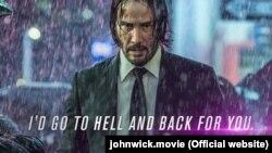 Плякат фільму «Джон Уік 3». Подпіс кажа: «Я пайду за табой у пекла і назад»