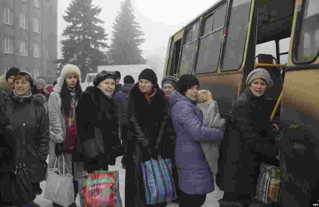 Local citizens board a bus to be evacuated from the town of Debaltsevo in the Donetsk region.