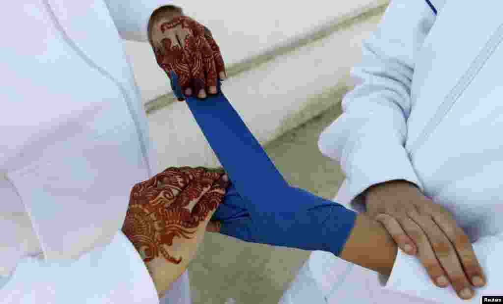 The hands of a boxer get wrapped before competing in the Sindh Junior Sports Association Boxing Tournament in Karachi.