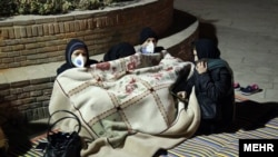 PHOTO GALLERY: Sleepless In Iran: After Latest Earthquake, Tehranis Brave The Cold