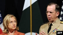 Pakistan -- US Secretary of State Hillary Clinton is watched by Chairman of the US Joint Chiefs of Staff, Admiral Mike Mullen as she speaks during a news conference at the US embassy in Islamabad, 27May2011