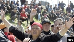 Squatters rally at the settlement of Nizhnyaya Alaarcha outside Bishkek on April 20.
