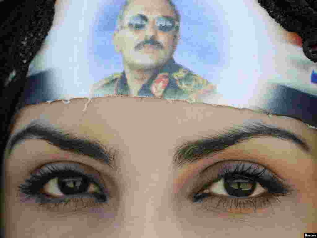 A woman wears a headband with a picture of Ali Abdullah Saleh during a rally in support of the Yemeni president in Sanaa on October 14. (Photo by Mohamed al-Sayaghi for Reuters)