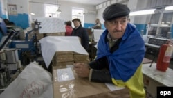 Members of a local election commission inspect ballot papers in Mariupol, Ukraine, where polling remained closed.