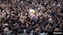Iran -- Mourners carry the coffin of Amin Karimi, a member of Iranian Revolutionary Guards who was killed in Syria, during his funeral in Tehran, October 28, 2015