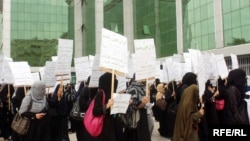 Women in Kabul protest in Kabul against plans for legislative changes curbing protections.