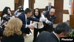 Armenia - Marina Khachatrian of the opposition Yerkir Tsirani party is confronted by pro-government members of Yerevan's municipal assembly, 13 February 2018.