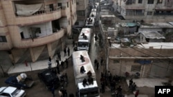 A Red Crescent convoy carrying humanitarian aid arrives in Kafr Batna, in the rebel-held Eastern Ghouta area, on the outskirts of the capital Damascus earlier this week.
