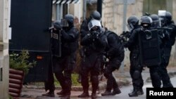 French special intervention police conduct a house-to-house search in Longpont, northeast of Paris on January 8, 2015.