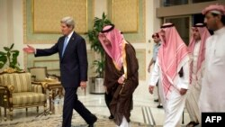 U.S. Secretary of State John Kerry (left) is welcomed by Saudi officials upon his arrival in Riyadh on November 3.