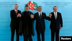 Hamid Karzai (second from left) made his comments while attending a summit with Turkish Prime Minister Recep Tayyip Erdogan (left), Turkish President Abdullah Gul (second from right) and Pakistani Prime Minister Nawaz Sharif (right).