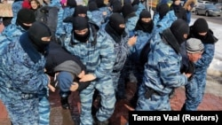 Kazakh police officers detain protesters during an opposition rally in Nur-Sultan earlier this year.