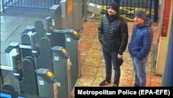 The suspects known as Aleksandr Petrov (right) and Ruslan Boshirov stand in Salisbury train station on March 3