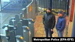Russian suspects Aleksandr Petrov (right) and Ruslan Boshirov stand at Salisbury train station on March 3.