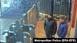 Both suspects, Aleksandr Petrov (right) and Ruslan Boshirov, stand at Salisbury train station on March 3, 2018.