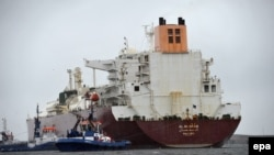 A liquified-natural-gas tanker from Qatar enters the terminal port of Swinoujscie in Poland