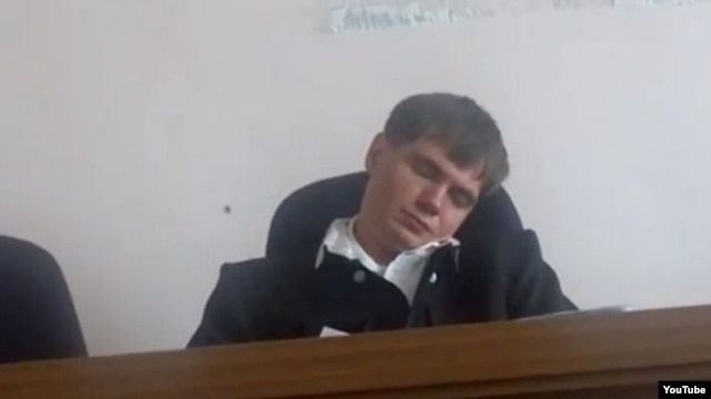 Judge Yevgeny Makhno of Blagoveshchensk city court dozes off in court during a hearing in August 2012.