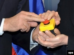"The red button that Hillary Clinton (right) used to symbolically declare a ""reset"" of U.S. relations with Moscow to her Russian counterpart Sergei Lavrov (left) in Geneva n 2009."