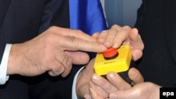 U.S. Secretary of State Hillary Clinton presents a symbolic reset button to Russian Foreign Minister Sergei Lavrov in March 2009 in Geneva