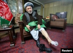 Ahmad Ishchi, who said he was beaten and detained by Afghan Vice President Abdul Rashid Dostum, displays an injury on his leg during an interview at his home in Kabul on December 13.