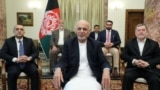 Flanked by his vice presidents and key advisers Afghan President Ashraf Ghani addressed the nation on March 24.