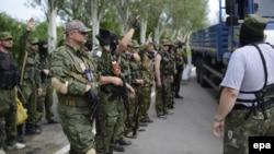 Бойовики угруповання «ДНР», яке в Україні на офіційному рівні визнано терористичною організацією