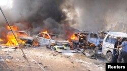 Սիրիա - Դամասկոսում պայթյունից հետո մեքենաներ են այրվում, 21-ը փետրվարի, 2013թ.