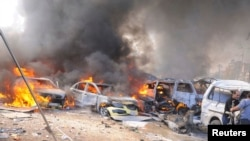 Vehicles burned after the February 21 explosion in Damascus.