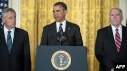 U.S. President Barack Obama is flanked by his nominees for CIA director, John Brennan (right), and defense secretary, Chuck Hagel, in Washington on January 7.