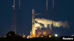 An unmanned Space Exploration Technologies' Falcon 9 rocket is seen on the launching pad at Cape Canaveral, Florida, a week ahead of the successful December 3 mission.