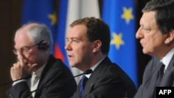 Russia's Dmitry Medvedev is flanked at the EU-Russia summit by Commission President Jose Manuel Barroso (right) and EU President Herman Van Rompuy.