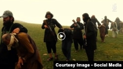 Grab from a video that shows militants loyal to the Islamic State (IS) blowing up bound and blindfolded Afghan prisoners with explosives. The victims were from Nangarhar Province. IS released the video in August 2015.