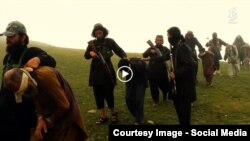 FILE: Grab from a video that shows militants loyal to the Islamic State (IS) blowing up bound and blindfolded Afghan prisoners with explosives. The video was released in August 2015.
