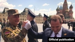 Russia -- Armenian Defense Minister Davit Tonoyan (R) greets Colonel Ashot Hakobian who led Armenian soldiers that marched through Red Square in a Russian miliary parade, Moscow, June 24, 2020.
