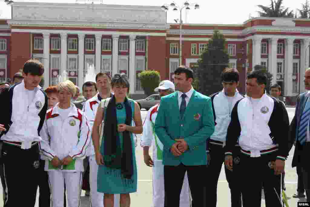 The Tajik Olympic team, posing in Dushanbe, also wear formal dress with subtle Central Asian flourishes.