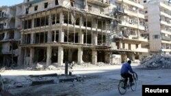 Разрушенное здание в восточной части Алеппо