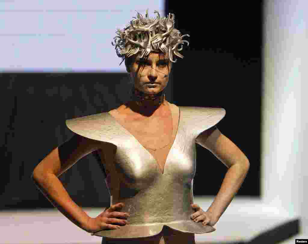 Karina Kasenova was reponsible for this futuristic garb.