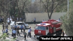 Tajikistan -- Policemen and firefighters work at the site of a bomb explosion in Khujand, 03Sep2010