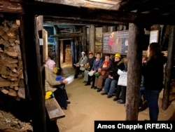 Bosnian tourists sit inside the tunnel network in Visoko where Djokovic went to meditate. A local expert told AFP the tunnels are probably the remnants of a disused gold mine.