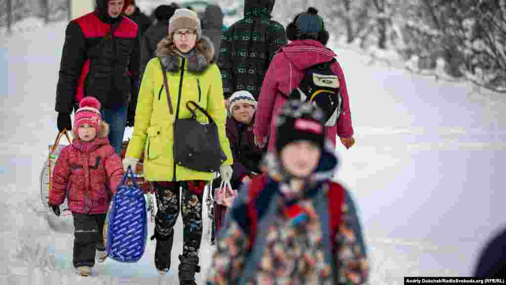 A young family heading toward separatist-held territory.