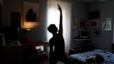 Francesca Valagussa, 40, practices yoga with an online course, in Rome, Italy, March 16, 2020. Italy entered its seventh day of a nationwide coronavirus lockdown after the Italian government has restricted movements for citizens and decided to shut down r
