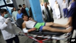An injured man arrives at a hospital in Kabul following attacks at a sports center in a Shiite neighborhood of of Afghanistan's capital on September 5.