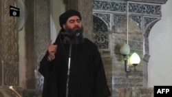 Abu Bakr al-Baghdadi in a 2014 video