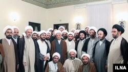 Ali Akbar Hashemi Rafsanjani (stands C) meets with clerics in Qom
