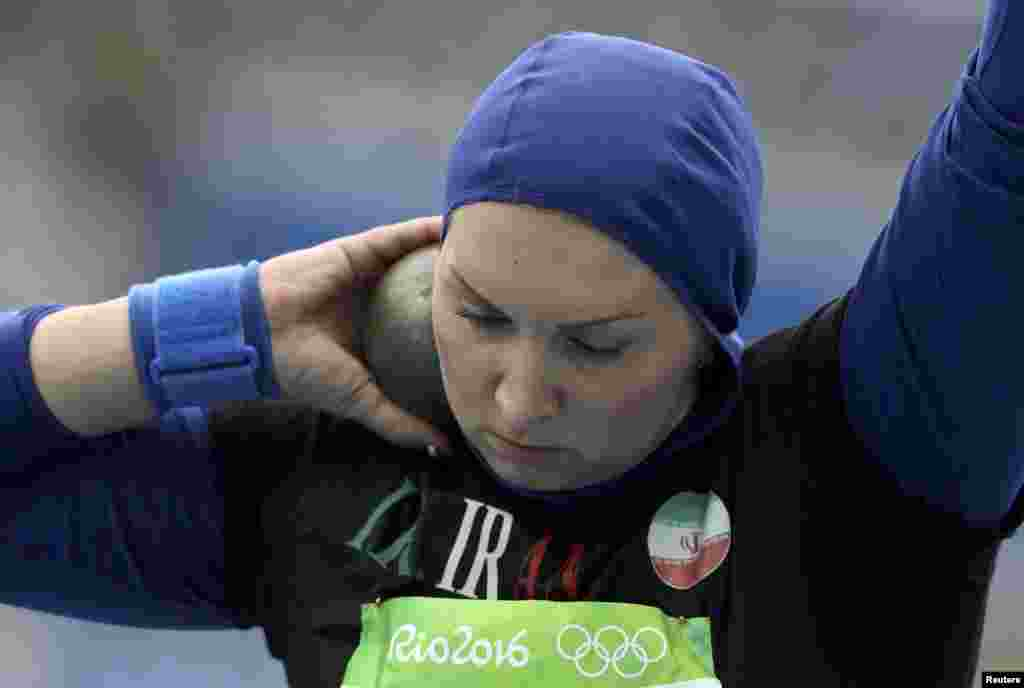 Leyla Rajabi of Iran competes in the women's shot put qualifying round.