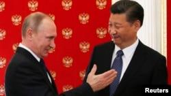Ресей президенті Владимир Путиннің Кремльде Қытай төрағасы Си Цзиньпинмен кездесуі. Мәскеу, 3 шілде 2017 жыл.